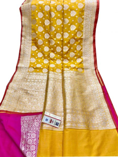 Yellow and silver katan banarasi silk sarees