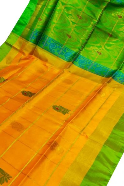 Orange and green uppada all over checks, rich pallu saree