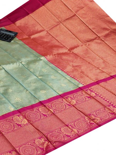 Mint green and maroon chanderi kanchi kuppadam all over butta saree