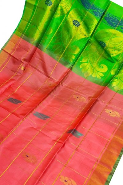 Carrot orange and green uppada all over checks, rich pallu saree