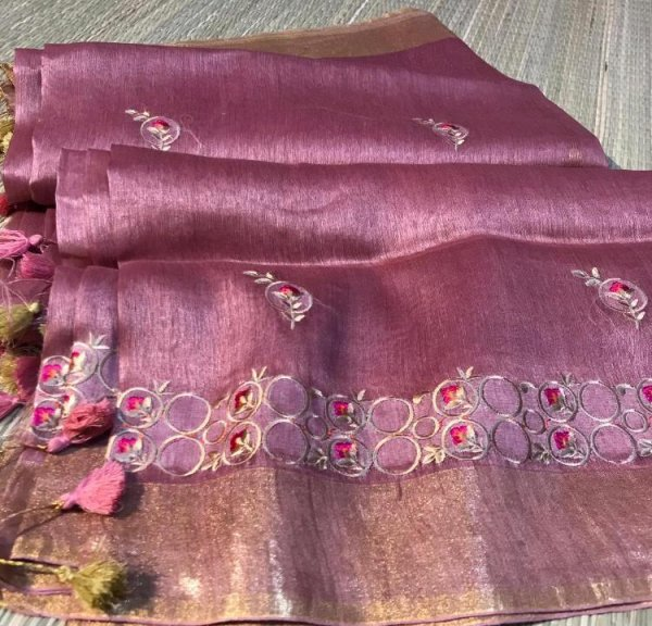 Purple linen embroidery saree with running blouse piece
