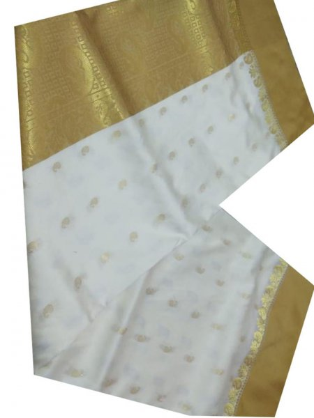 golden and white linen jamdani saree