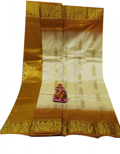 Mustard yellow and white all body buti designer Kanjivaram silk saree